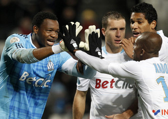 Olympique Marseille's goalkeeper Mandanda reacts with team mates after stopping a penalty during their French Ligue 1 soccer match at the Velodrome stadium in Marseille