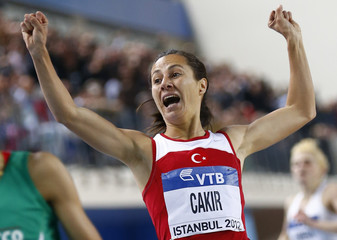 Cakir Alptekin of Turkey reacts after finish in women's 1500 metres final during world indoor athletics championships at Atakoy Athletics Arena in Istanbul