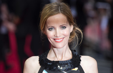 Actress Leslie Mann poses for photographers as she arrives for the UK Gala screening of The Other Woman in London