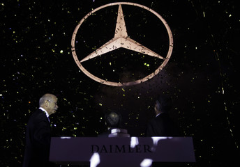 Daimler AG Chief Executive Zetsche, Beijing Vice Mayor Gou and the Chairman and CEO of Daimler Northeast Asia Walker attend the Mercedes-Benz Star lighting ceremony in Beijing