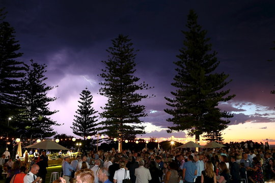Lightning flashes in the sky as Britain's Prince Charles and Camilla, Duchess of Cornwall attend a reception to celebrate the Prince's birthday at the Cottesloe Civic Centre in Perth