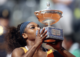 Williams of the U.S. kisses the trophy after winning women's singles final match against Azarenka of Belarus at the Rome Masters tennis tournament
