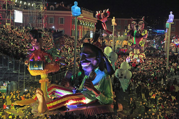 A float with a giant figure of late singer Bob Marley is paraded through the crowd during the Carnival parade in Nice