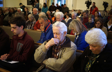Hank Pitstick prays at the Oso Community Chapel in Oso