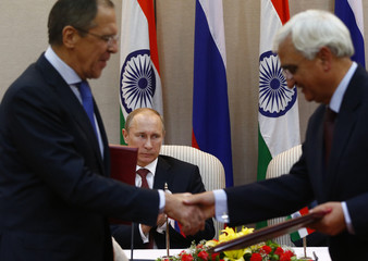 Russia's President Putin watches Russia's Foreign Minister Lavrov exchanges documents with his Indian counterpart Khurshid during a signing ceremony in New Delhi