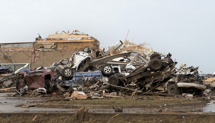 Destroyed cars lie in a heap after a huge tornado struck Moore, Oklahoma