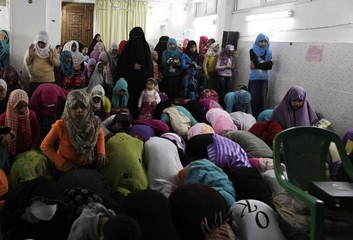 Children of Egypt's ultra-conservative Muslims, Salafists, pray before attending a religious lesson at a mosque popular with Salafists in Alexandria