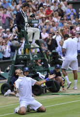 Novak Djokovic of Serbia reacts after defeating Jo-Wilfried Tsonga of France in their semi-final match at the Wimbledon tennis championships in London