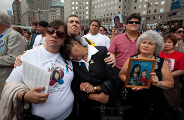 Victims family members listen to names being read on the 10th anniversary of the 9/11 attacks on the World Trade Center, in New York