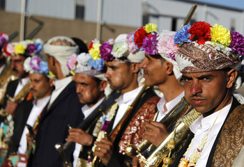 Grooms who are members of the Republican Guards Forces pose for a picture during a mass wedding for members of the force in Sanaa