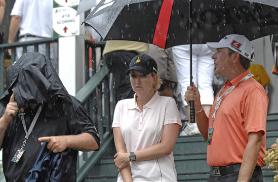 Webb of Australia leaves the course after play was suspended for rain and lightning during the second round of the Women's U.S. Open Golf Championship in Oakmont