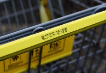 A Best Buy electronics shopping cart is seen in the parking lot of the store in Westbury