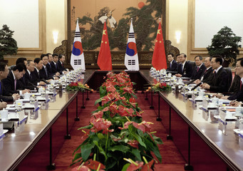South Korea's President Lee Myung-bak attends a bilateral meeting with his Chinese counterpart Hu Jintao at the Great Hall of the People in Beijing