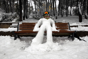 A snowman is seen on a bench in a park in northern Rome