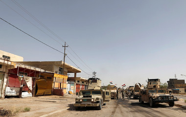 Iraqi army vehicles are seen in center of Falluja