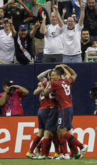 US players celebrate the winning goal against Panama during their CONCACAF Gold Cup semi-final soccer match in Houston