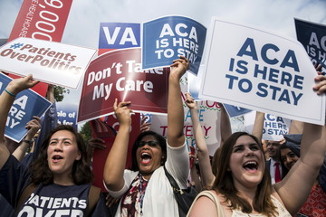 Supporters of the Affordable Care Act celebrate after the Supreme Court up held the law in the 6-3 vote at the Supreme Court in Washington