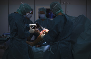 Doctors and medical staff work during  knee prosthesis surgery in an operation room at the hospital of the Canton of Nidwalden in Stans