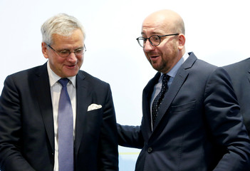 Belgian PM Michel and Deputy PM Peeters arrive to address a news conference in Brussels