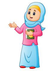 Muslim women wearing blue veil with holding quran presenting