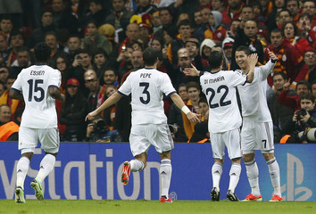 Real Madrid's Ronaldo celebrates with his team mates Di Maria, Pepe and Essien after scoring a goal against Galatasaray during their Champions League quarter-final second leg soccer match in Istanbul