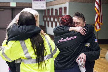 Hazel Powers, who has worked at Boeing for 35 years, reacts with fellow union members after hearing the result of a union vote in Seattle