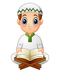 boy read quran the holy book of islam