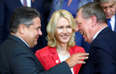 German Economy Minister Gabriel talks to Polish Environment Minister Szyszko beside German Family Minister Schwesig during government consultations at the chancellery in Berlin