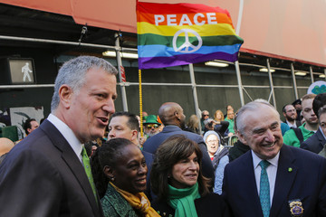 New York Mayor de Blasio, his wife, McCray, NYPD Police Commissioner Bratton and his wife Kliemanduring pose for a picture as they wait for the start of the St. Patrick's Day parade in New York