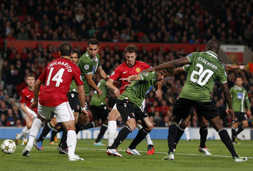 Manchester United's Evans scores against Braga during their Champions League Group H soccer match at Old Trafford in Manchester