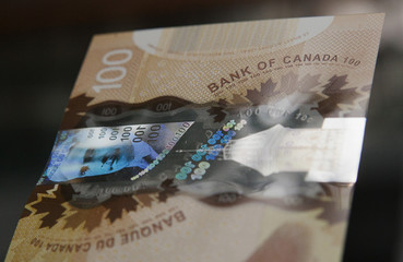 A hologram security feature is seen on the new Canadian 100 dollar bill made of polymer in Toront