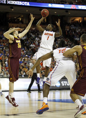 University of Florida guard Kenny Boynton shoots over University of Minnesota center Elliott Eliason during their third round NCAA basketball game in Austin, Texas