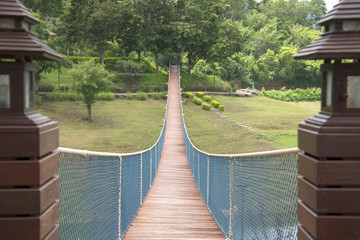 The rope bridge in the park directly onto the solitary island on the lake