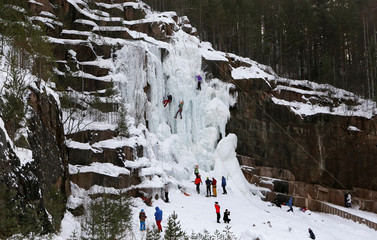"Climbers practice their skills at an ice fall at the ""Stolby"" (Rock Pillars) national natural reserve outside the Siberian city of Krasnoyarsk"