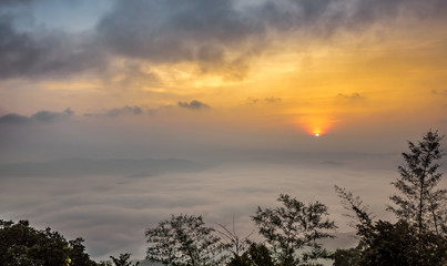 Aerial view of sunrise over mountain and fog in Nan province, Thailand. Doi Samoe Dao at Sri Nan National Forest Park, Northern of Thailand.