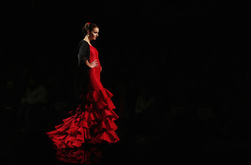 Model presents creation by Carmen G. Vazquez during the International Flamenco Fashion Show SIMOF in the Andalusian capital of Seville