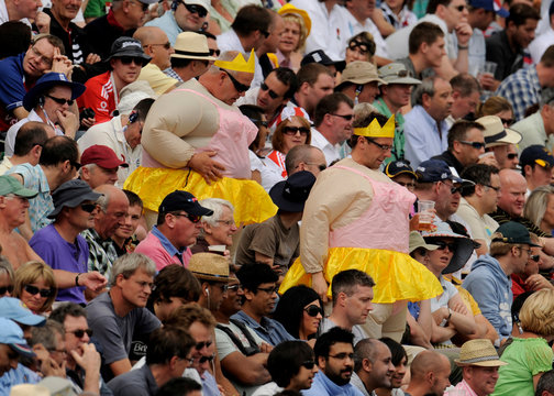 Spectators in fancy dress go down some stairs during the second cricket test match between England and India at Trent Bridge in Nottingham