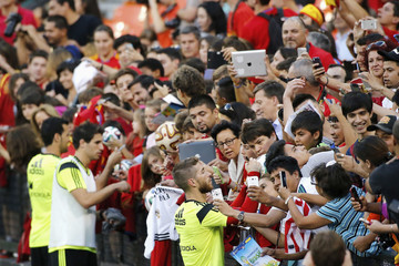 Spanish national soccer team players sign autographs for supporters after a training session at RFK Stadium in Washington