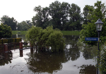 Water of Oder River stands in garden of house after it broke its banks in east German town of Eisenhuettenstadt