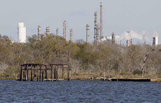 What used to be a boat house in the former Brownwood neighborhood (lower left) with a refinery in the background is seen in Baytown