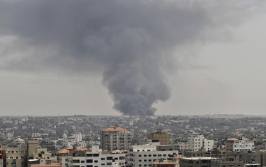 Smoke rises following what police said was an Israeli tank's shelling that hit the industrial area in the east of Gaza City