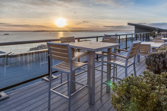rooftop deck with water view at sunset
