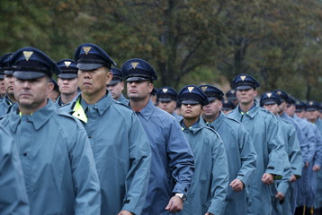 NY State Police officers march in the rain ahead of funeral service for slain New York City Police officer Randolph Holder in New York