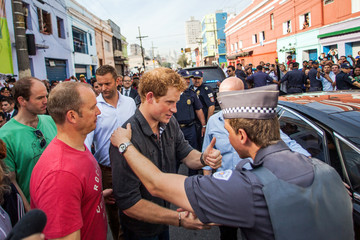 Britain's Prince Harry meets residents during a visit to Sao Paulo's Luz neighborhood known to locals as Cracolandia (Crackland), in Sao Paulo