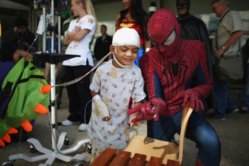 Mattel Children's Hospital UCLA patient Gael Martin, 5, meets a window washer dressed as Spider-Man in Los Angeles