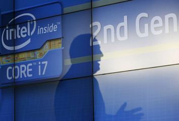 Intel CEO Otellini casts shadow on video wall during a press conference at the Consumer Electronics Show (CES) in Las Vegas