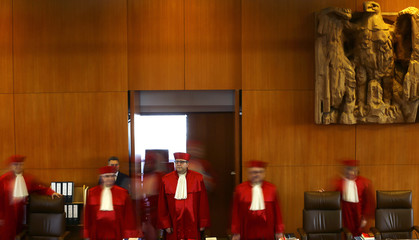 Vosskuhle President of Germany's Constitutional Court leads his fellow judges into courtroom for start of trial against NPD in Karlsruhe