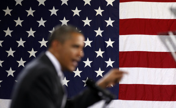 U.S. President Barack Obama speaks next to flag at Southern Maine Community College in Maine