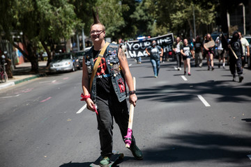 Anti-fascist counter-protestors parade through Sacramento after multiple people were stabbed during a clash between neo-Nazis holding a permitted rally and counter-protestors on Sunday at the state capitol in Sacramento.