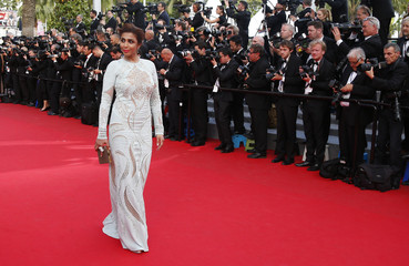 "Yemeni singer and television host Arwa poses on the red carpet as she arrives for the screening of the film ""How to Train Your Dragon 2"" out of competition at the 67th Cannes Film Festival in Cannes"